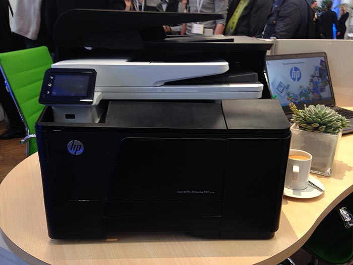 HP's new toner formulation and cartridge design has enabled it to reduce the size of its printers and MFPs. Here, a new MFP (in white) easily fits within the shell of the machine it is replacing (in black).
